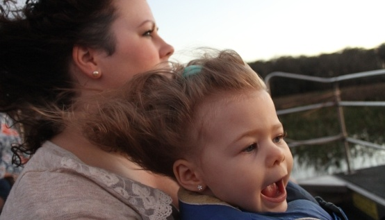 Young child and her mother enjoying a Wild Florida airboat tour.