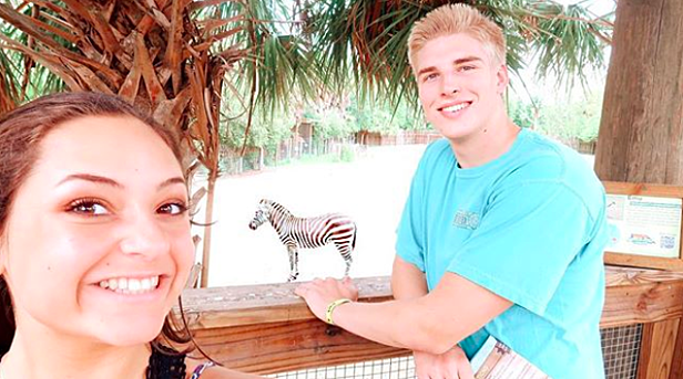 Teenagers walking through Wild Florida's Gator Park