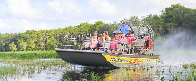Group touring the Everglades in an airboat at Wild Florida