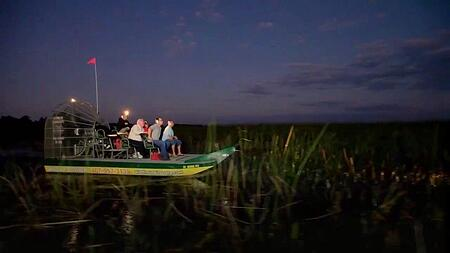 riding an airboat at night